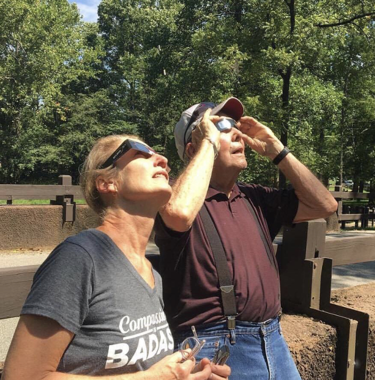 Faith and her father looking at the eclipse